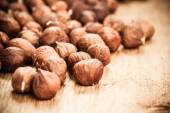 Hazelnuts on rustic old wooden table — Stock Photo
