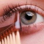 Closeup part of woman face eye makeup detail. — Stock Photo #52568575