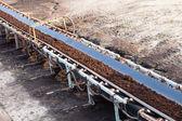 Opencast brown coal mine. Belt conveyor. — Stock Photo