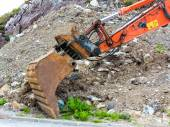 Excavator digger shovel on construction site — Stock Photo