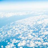 Sky. View from window of airplane flying in clouds — Stock Photo