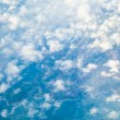 White cloudy sky. View from airplane flying in clouds. — Stock Photo #52845533