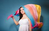 Summer woman with colored shawl on blue — Стоковое фото