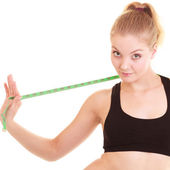 Diet. Fitness woman fit girl with measure tape — Stock Photo