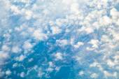 White cloudy sky. View from airplane flying in clouds. — Stock Photo