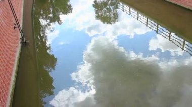 Sky and clouds reflection in water — Stock Video