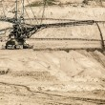 Opencast brown coal mine. Giant excavator. — Stock Photo #53007055