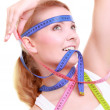 Obsessed fitness woman with a lot of colorful measure tapes — Stock Photo #53007333