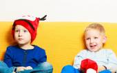 Little boy in red winter reindeer hat with his brother — Stock fotografie
