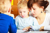 Mother and children sons drawing together — Stock Photo