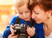 Mother and child playing with camera taking photo — Stock Photo