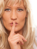 Woman asking for silence finger on lips hush gesture. — Stock Photo