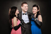 Love triangle. Two laughing women and man. Fun. — Stock Photo