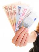 Economy finance. Woman holds euro currency money. — Stock Photo