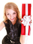 Happy woman holds red christmas gift box. Holidays. — 图库照片