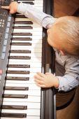Boy child kid playing on digital keyboard piano synthesizer — Stock Photo