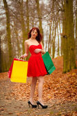 Woman with sale bags in park — Foto de Stock