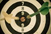 Black and white target with darts — Stock Photo