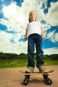 Skater boy child with skateboard — Stock Photo