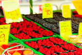 Raspberries in containers at market — Stock Photo