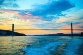 Sunset over suspension bridge — Stock Photo