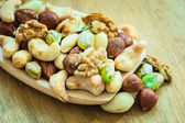 Mix of nuts on spoon — Stock Photo