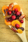 Varieties of dried fruits on spoon — Stock Photo