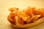 Candied ginger on wooden spoon — Stock Photo