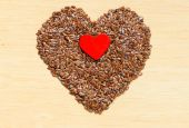 Flax seeds linseed heart shaped — Stock Photo