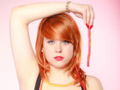 Redhair girl holding jelly candy — Stock Photo