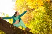 Woman relaxing in autumnal park — Stock Photo