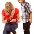 Mother and son playing video game — Stock Photo #53776841