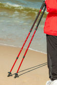 Female legs hiking on beach — Stock Photo