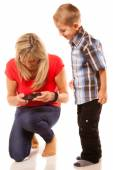 Mother and son playing video game — Stockfoto