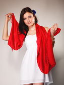 Woman in dress with red shawl — Stock Photo