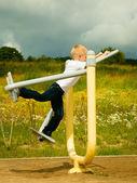 Boy play on stretching equipment — Stock Photo