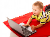 Education, technology internet - little boy with laptop — Stock Photo