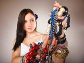 Girl with plenty of jewellery — Stock Photo
