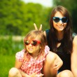 Mother and girl kid in sunglasses — Stock Photo #54157355