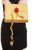 Female hands giving christmas gift box — Stok fotoğraf