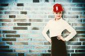 Female engineer architect in helmet — Stock Photo