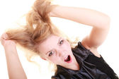 Woman screaming and pulling messy hair — Stock Photo