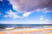 Cloudy sky at sea on beach — Stock Photo