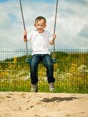 Little boy having fun on swing — Foto de Stock