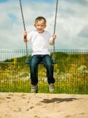 Little boy having fun on swing — Stock Photo