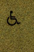 Handicapped sign on wall — Stock Photo