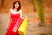 Woman with sale bags in park — Stockfoto
