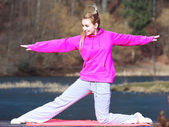 Woman in tracksuit doing exercise — Stock Photo