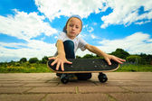 Skater boy with his skateboard — Stock Photo