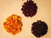 Dried fruits raisins apricots cranberries — Stock Photo